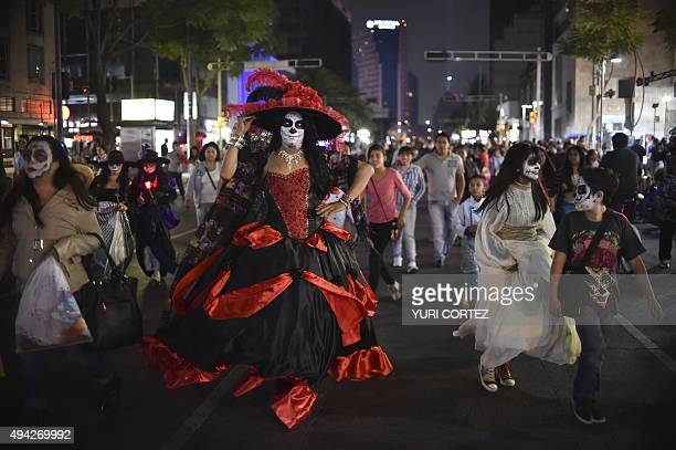 Woman with their faces painted as The Catrina take part in the Procession of the Catrinas along Reforma Avenue in Mexico City on October 25 2015...