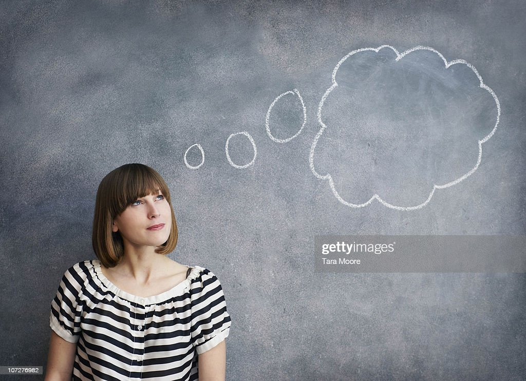 woman with thought bubble on chalk board : Stock Photo