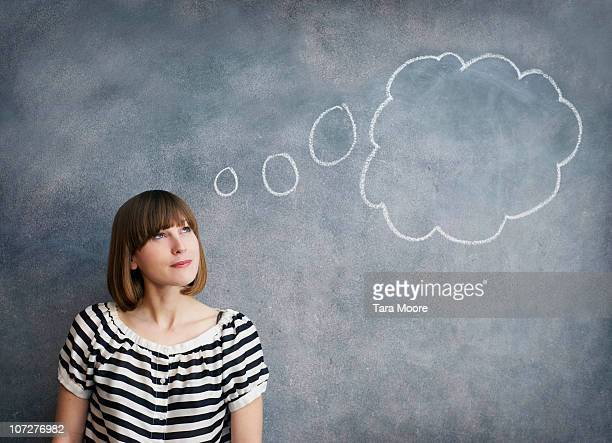 woman with thought bubble on chalk board - contemplation stock pictures, royalty-free photos & images