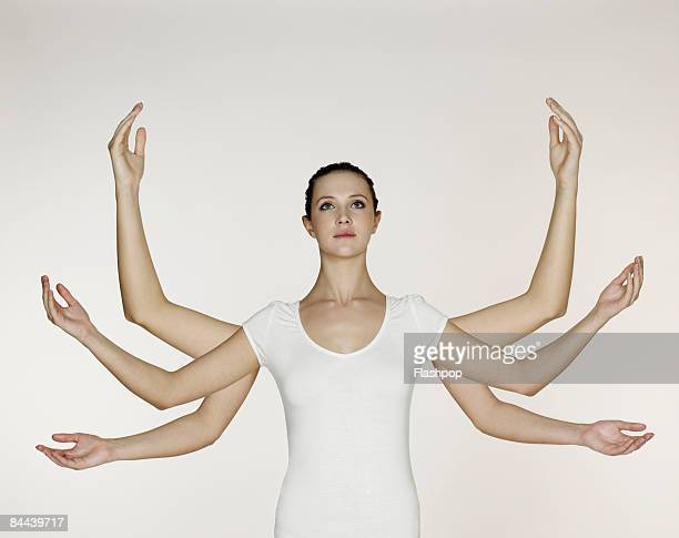 Woman with three pairs of arms and hands