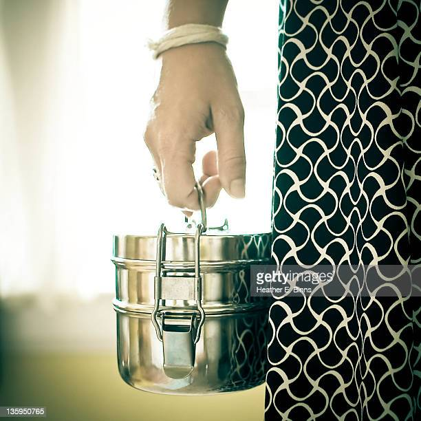 woman with tiffin lunchbox - tiffin box photos et images de collection