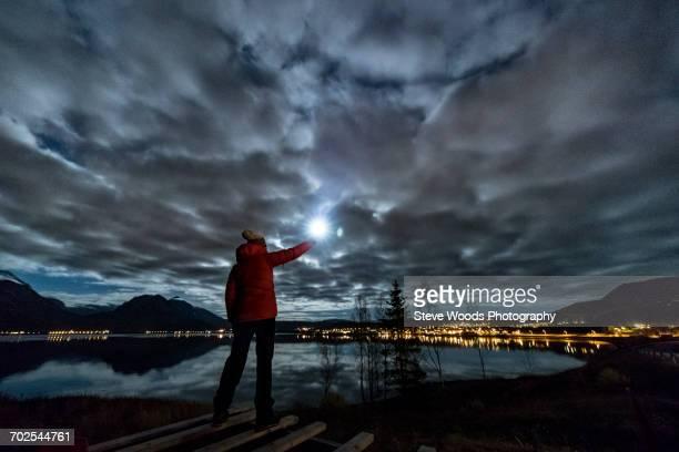 woman with torch near tromso in autumn, arctic norway - isla mujeres fotografías e imágenes de stock