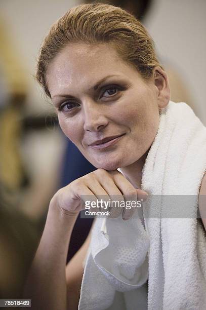 Woman with towel around her neck