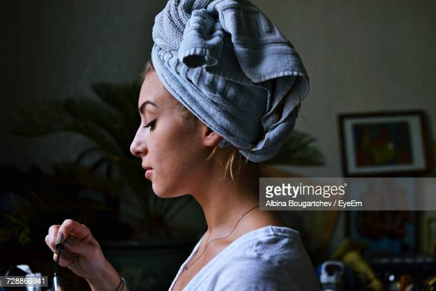 Woman With Towel Wrapped Around Her Head