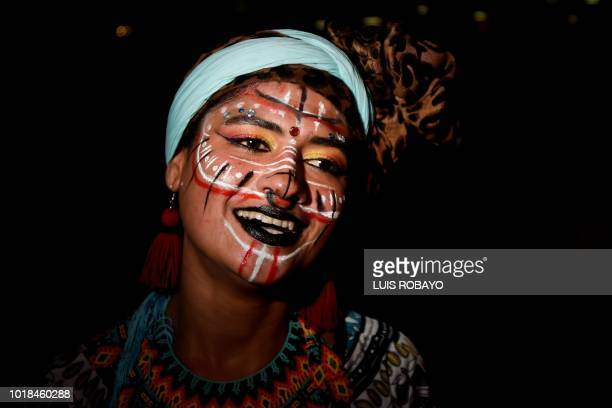 A woman with traditional face paint dances during the XXII Petronio Alvarez Pacific Music Festival in Cali Colombia on August 17 2018 The Petronio...