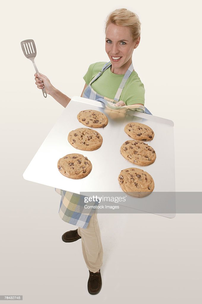 Woman with tray of cookies : Stockfoto