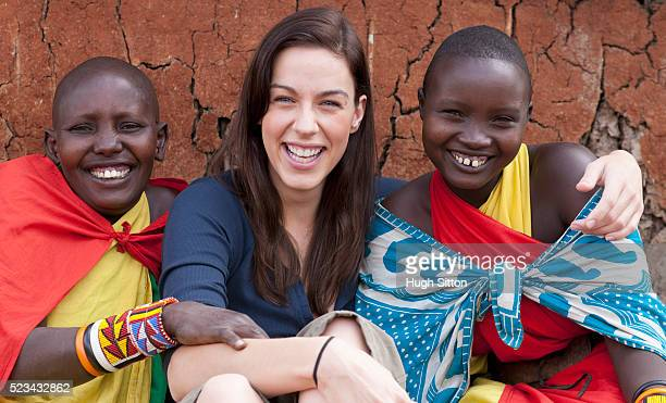 woman with tribespeople - hugh sitton stock pictures, royalty-free photos & images
