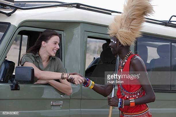 woman with tribesperson - hugh sitton stock-fotos und bilder