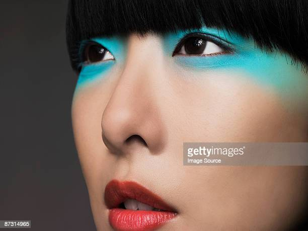 woman with turquoise eyeshadow - eye make up stock pictures, royalty-free photos & images