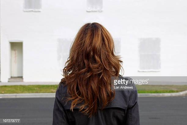 woman with tussled long hair - brown hair stock pictures, royalty-free photos & images