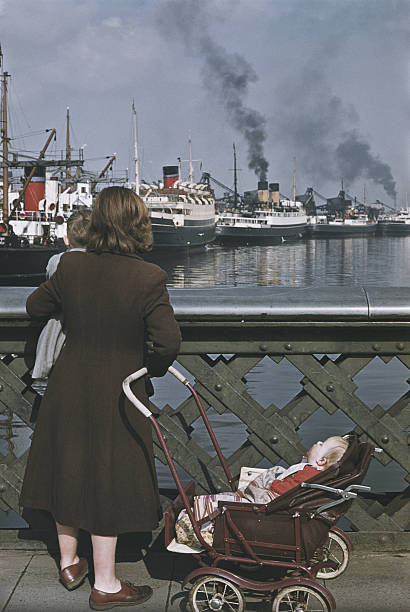 A woman with two children stops to look at shipping...