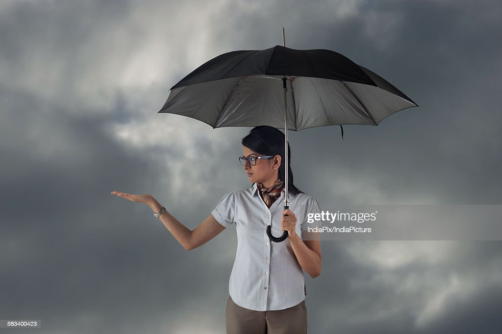 Woman with umbrella feeling for rain : Stock Photo