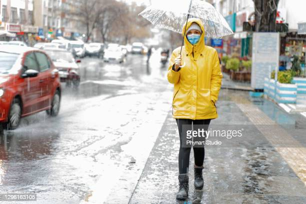 woman with umbrella  on rainy day - cold and flu stock pictures, royalty-free photos & images