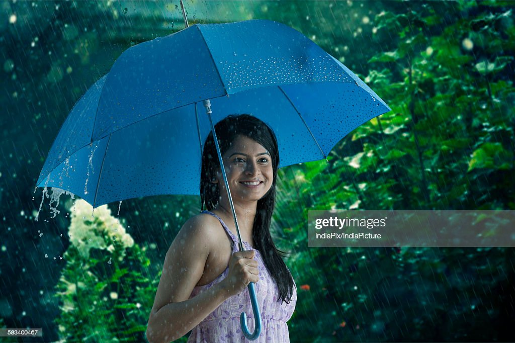 Woman with umbrella smiling : Stock Photo