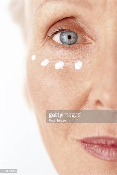 Woman with under-eye moisturizer