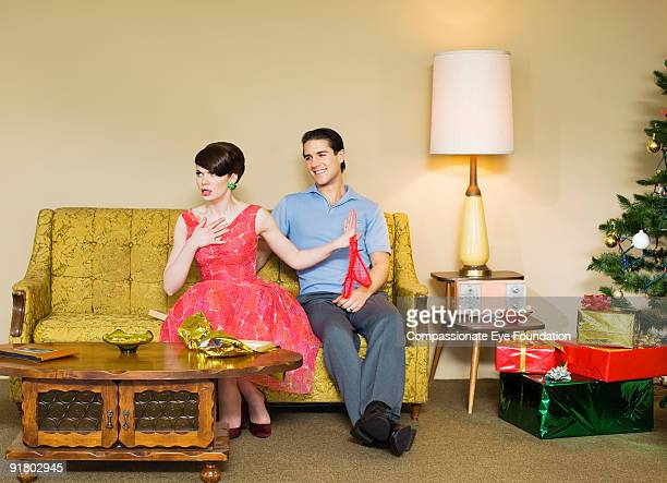 woman with upset expression from recieving gift