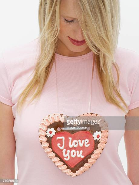 Woman with valentines cookie
