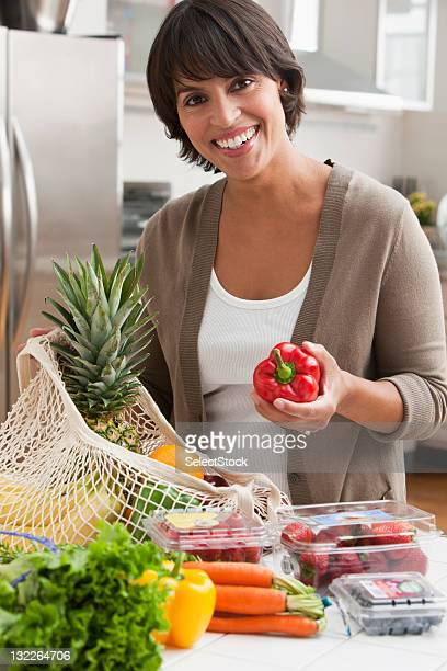 Woman with vegetable groceries