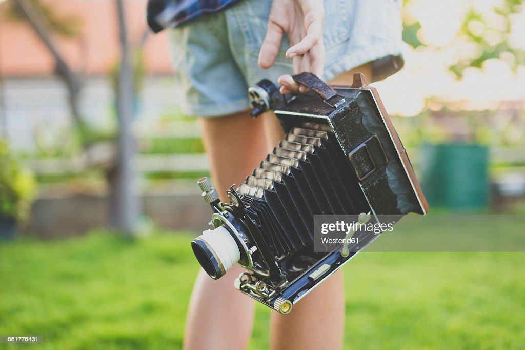 Woman with vintage camera : Stock Photo