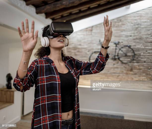Woman with virtual reality glasses at home