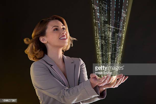 Woman with virtual technological information in her hands