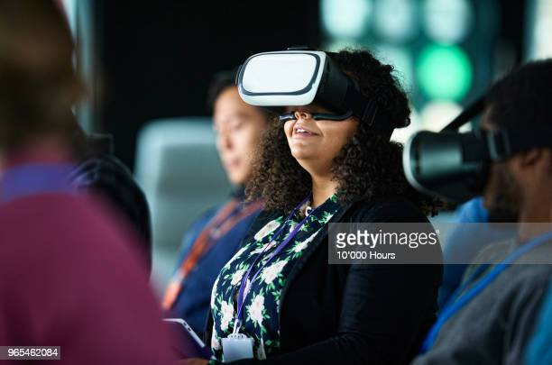 woman with vr glasses at conference - cyberspace stock pictures, royalty-free photos & images