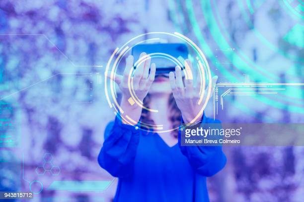 woman with vr glasses - rechnerunterstützte fertigung stock-fotos und bilder