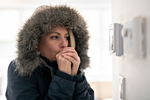 Woman With Warm Clothing Feeling The Cold Inside House 1070035592