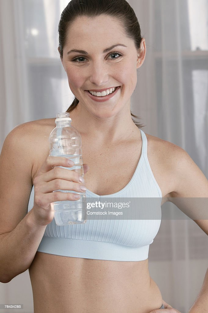 Woman with water bottle : Stockfoto