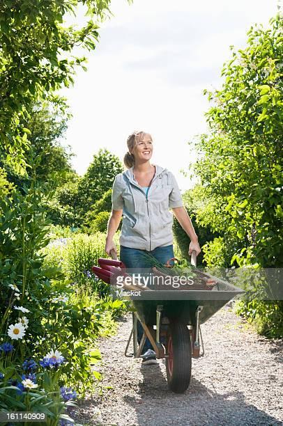 Woman with wheelbarrow