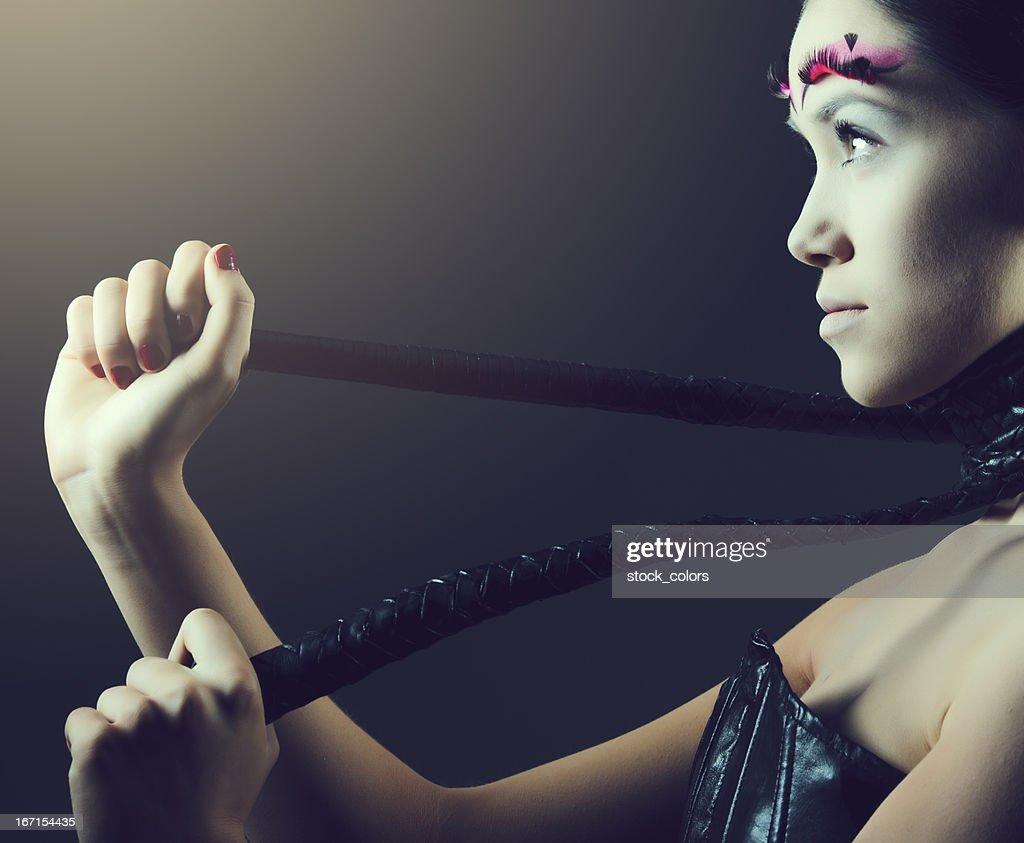 woman with whip : Stock Photo