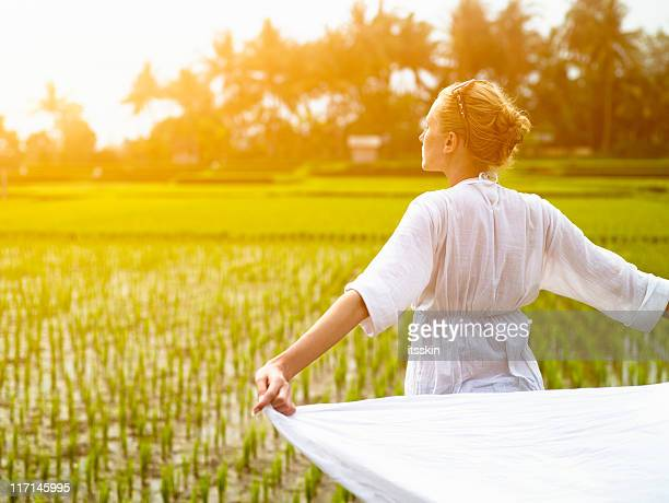 Woman with white cloth in the rice field
