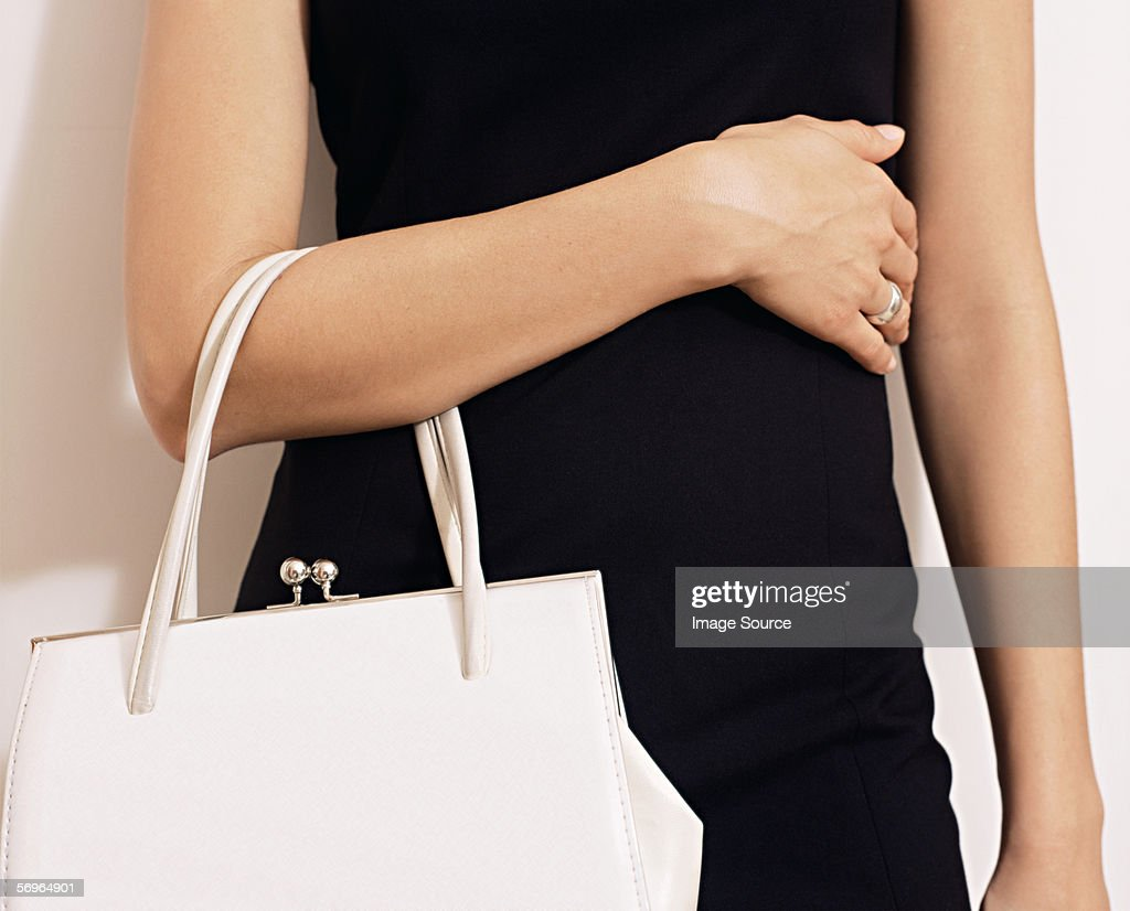 Woman with white handbag : Stock Photo