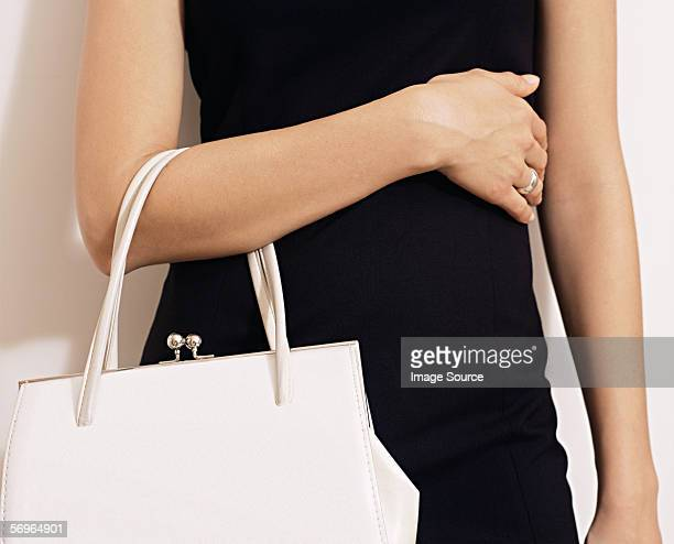 Woman with white handbag