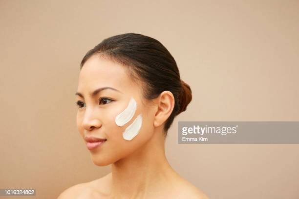 woman with white marks on cheek - three quarter length stock pictures, royalty-free photos & images