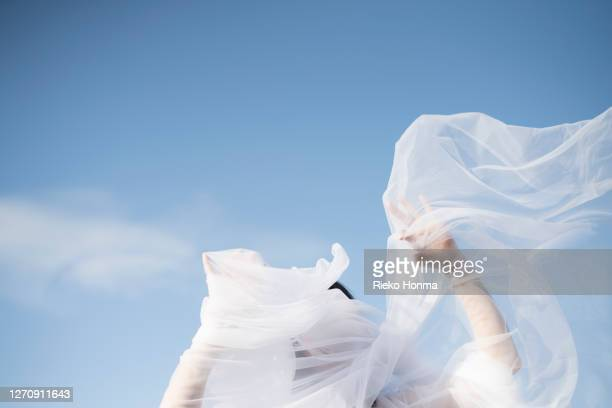 woman with white veil blowing over face - 女性 ストックフォトと画像