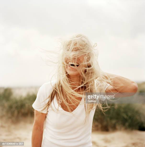 Woman with windswept hair on beach