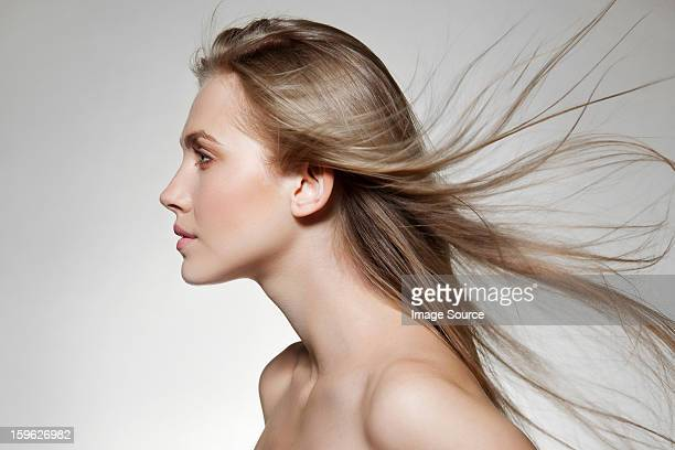 Woman with windswept long hair