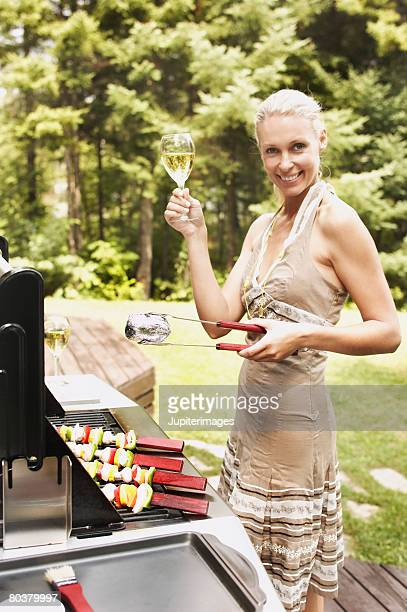Woman with wine grilling