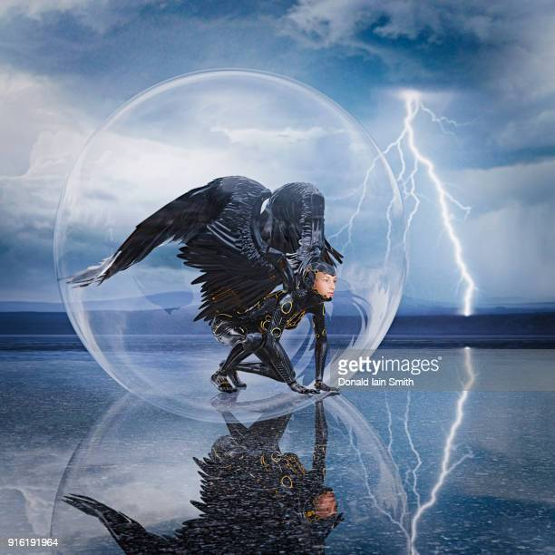 woman with wings kneeling in sphere during lightning storm - crow bird stock photos and pictures