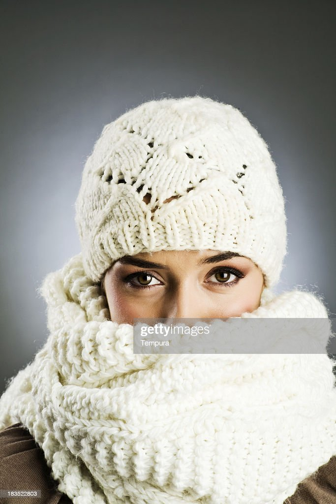Woman with woolen cap and scarf Vetical : Stock Photo