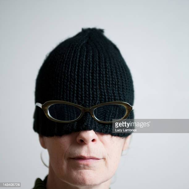 Woman with woolen hat and glasses
