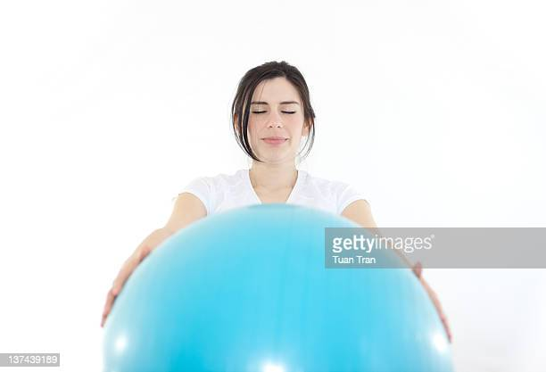 Woman with working out with exercise ball