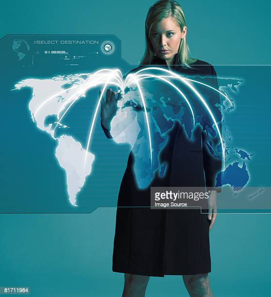 Woman with world on screen
