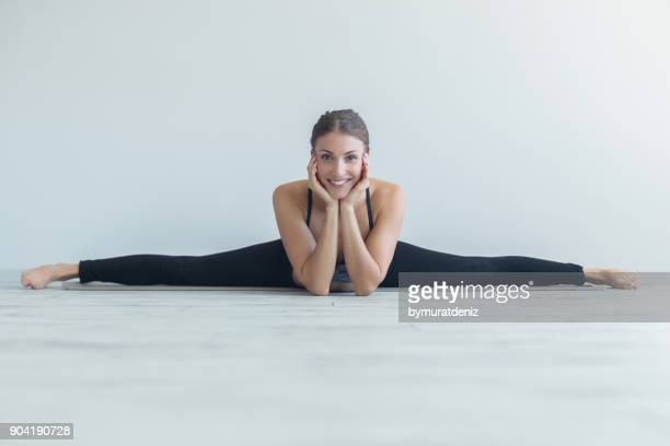 woman with yoga to start the day - doing the splits stock photos and pictures
