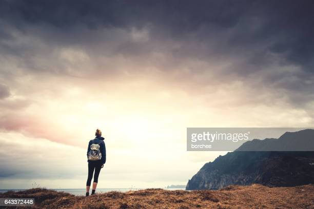 woman wnjoying the beautiful outdoors - madeira island stock photos and pictures