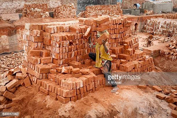 NARAYANGONJ DHAKA BANGLADESH Woman work at a brick factory in Narayangonj Bangladesh June 01 2016 This group of people comes from sunamgonj outside...