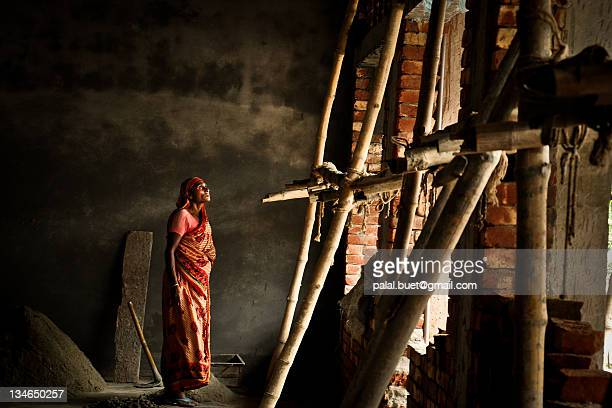 woman worker at construction site - khulna stock photos and pictures