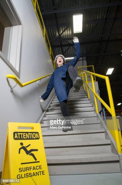 Woman worker falling down the stairs