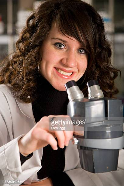 woman worker in a laboratory - rich_legg stock photos and pictures